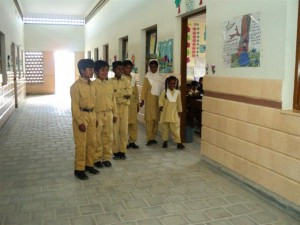 A group photo of students standing just outside their classes