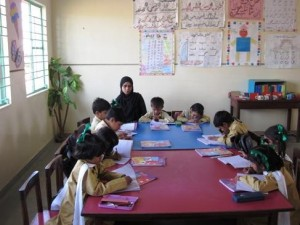 Recently enrolled KG students learning their early lessons