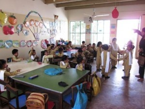 Kindergarten(KG) students enjoying an activity in their colorful classroom
