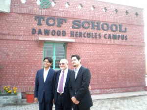 Esteemed Donor with his Sons Pose in front of the Campus they have Built and Supported