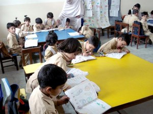 Young students busy in their class work