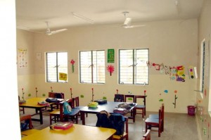 Sunbeams pouring inside this empty classroom where children have gone off to enjoy their mid-day break