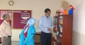 TCF CEO checks out the books in the library