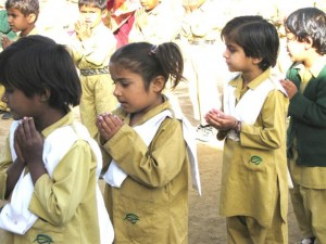 Children Performing Dua in Assembly