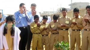 Students Performing Dua Plantation in School