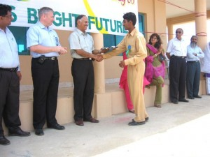 A student receives his gift from former TCF CEO Lt. Gen. (R) S P Shahid
