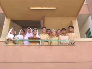 Classmates Pose in front of their Campus