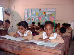 Two class fellows engrossed in their books