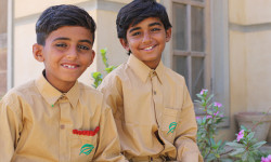 Shahbaz & Mushtaq are all smiles as they return to school!